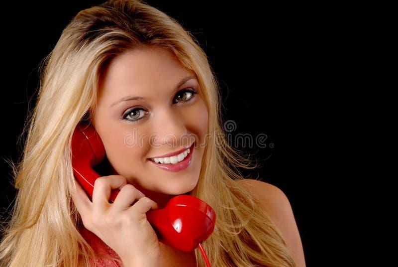 Beau femme blond au téléphone photo libre de droits