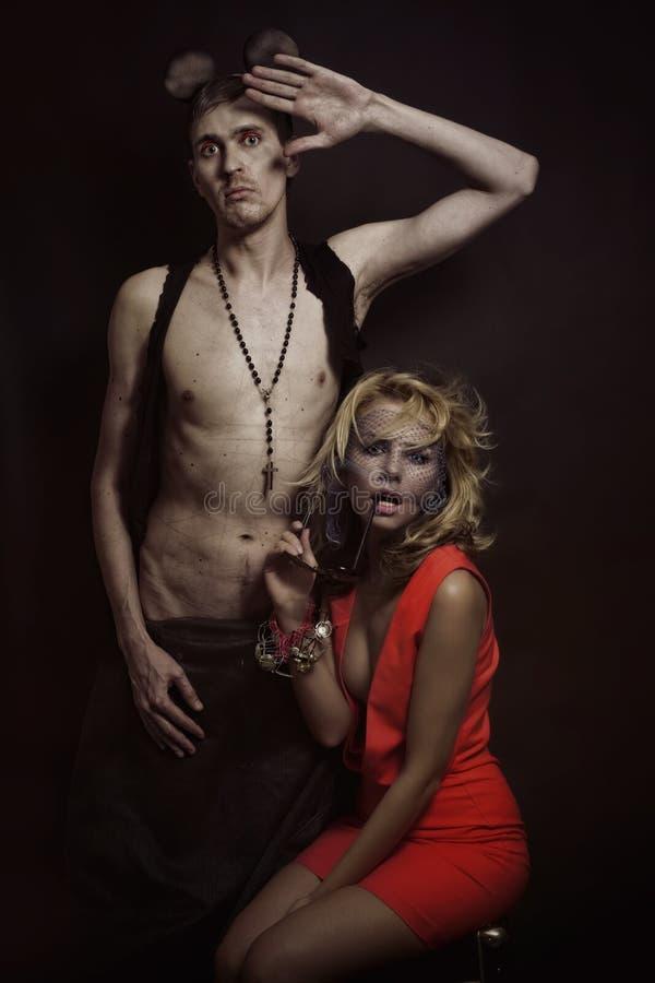 Beau femme blond et un homme avec la souris d'oreilles images libres de droits