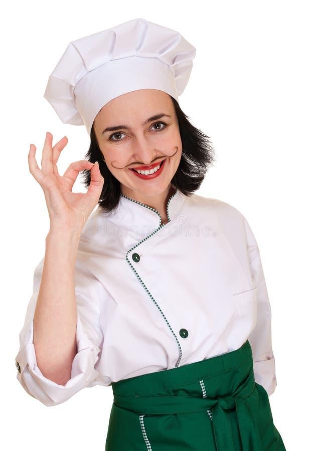 Beau femme dans l'uniforme de chef images stock