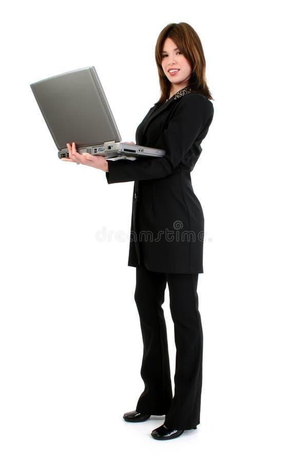 Beau femme hispanique avec l'ordinateur image stock
