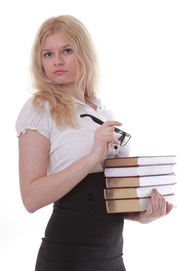 Beau jeune femme avec le fond de blanc de livres photographie stock libre de droits