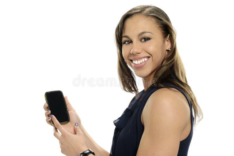 Beau jeune femme avec le téléphone portable photographie stock