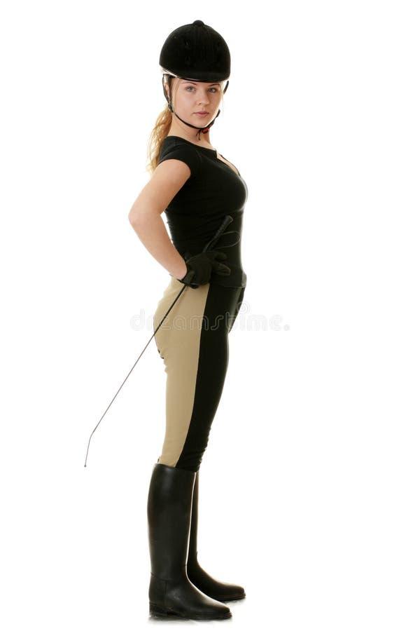 Beau jeune femme blond - femme jockey photographie stock