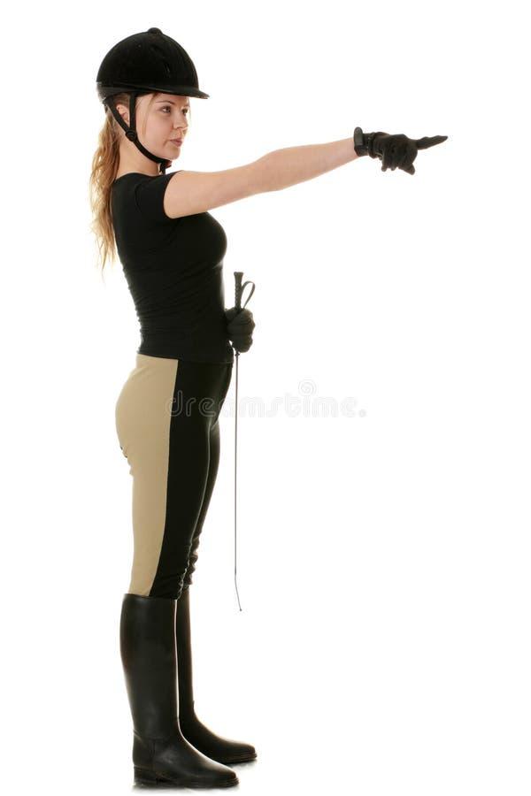 Beau jeune femme blond - femme jockey image libre de droits