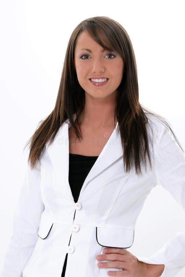Beau jeune femme d'affaires dans le blanc sur le blanc image libre de droits