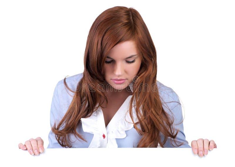 Beau jeune femme regardant vers le bas images libres de droits