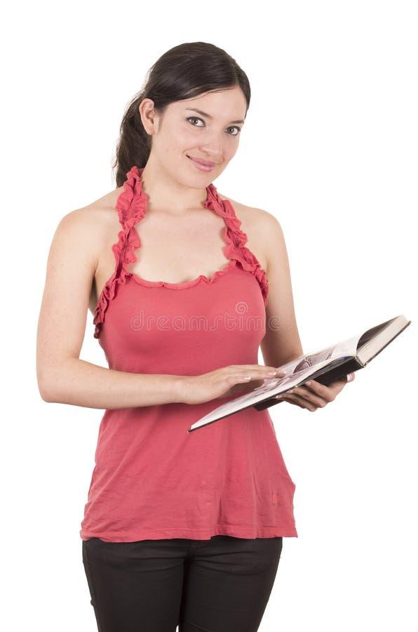 Beau jeune professeur féminin tenant le livre photographie stock libre de droits