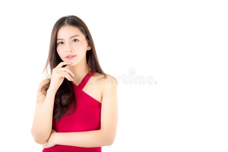 Beau jeune sourire asiatique de femme du portrait d'isolement sur le fond blanc photos libres de droits