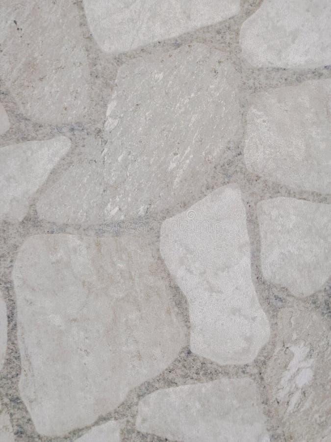 Beau plancher de tuiles abstrait de texture et fond et papier peint noirs et blancs de modèle de couleur de plat de roche photographie stock