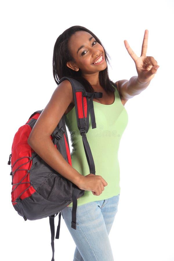 Beau signe noir de victoire de fille d'école d'adolescent images stock