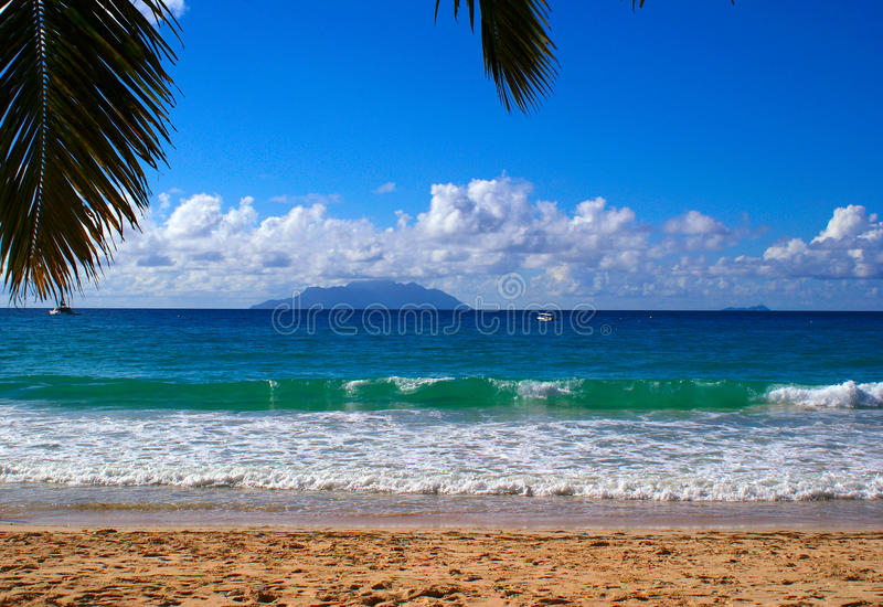 Beau Vallon beach. Silhouette island from bea vallon beach royalty free stock images