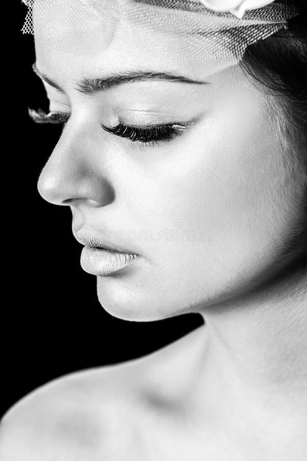 Beau visage de femme, image modifiée la tonalité photographie stock libre de droits
