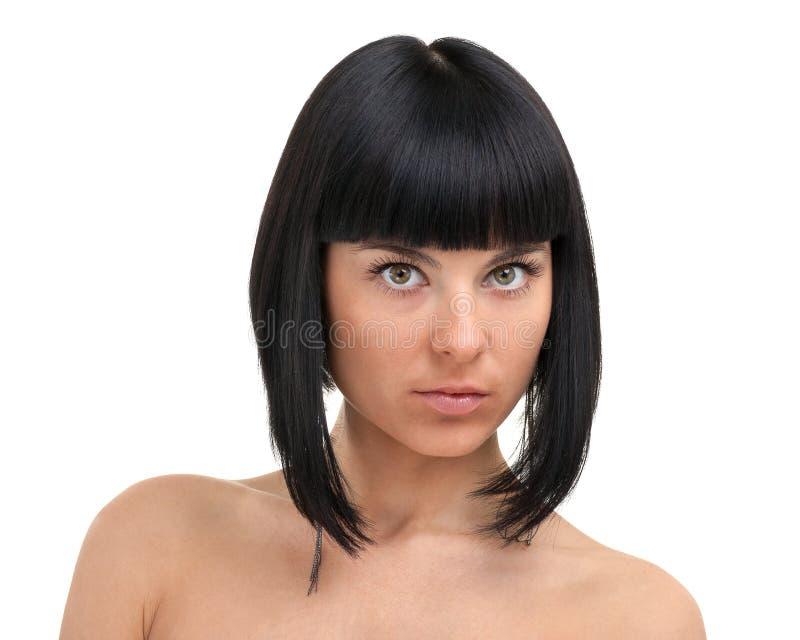 Beau visage de fin de jeune femme, d'isolement sur le fond blanc photographie stock