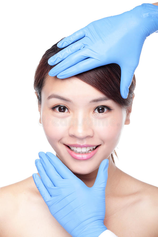 Beau visage femelle avec le gant de chirurgie plastique photo libre de droits