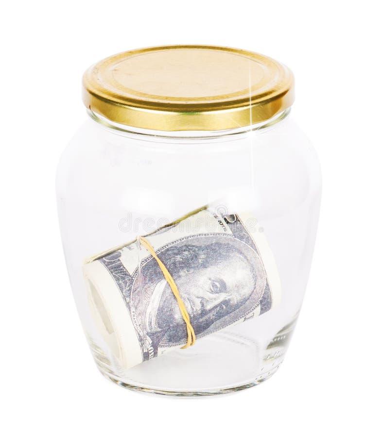 Beaucoup de billets de banque des dollars dans un verre photographie stock