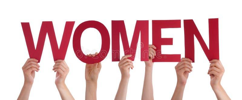 Beaucoup de mains de personnes tenant les femmes droites rouges de Word images libres de droits