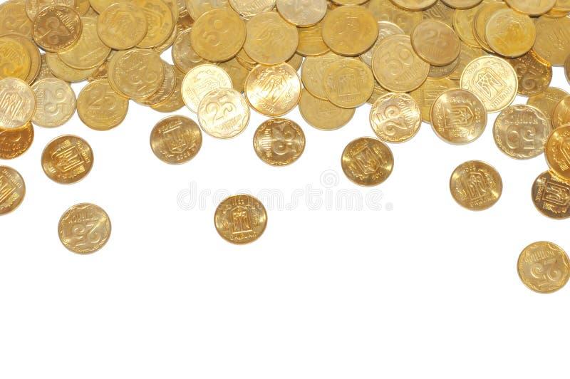 Beaucoup de pièces d'or au-dessus de blanc photo stock