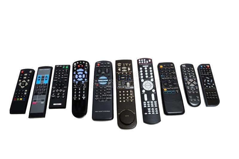 Beaucoup de vieilles télécommandes usées tirées sur l'angle image stock