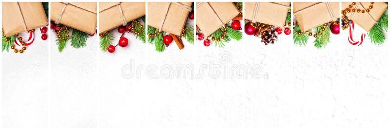 Beaucoup ensemble de cadeau de Noël Composition avec les boîte-cadeau de papier de métier beige naturel, branche verte de sapin d photographie stock libre de droits