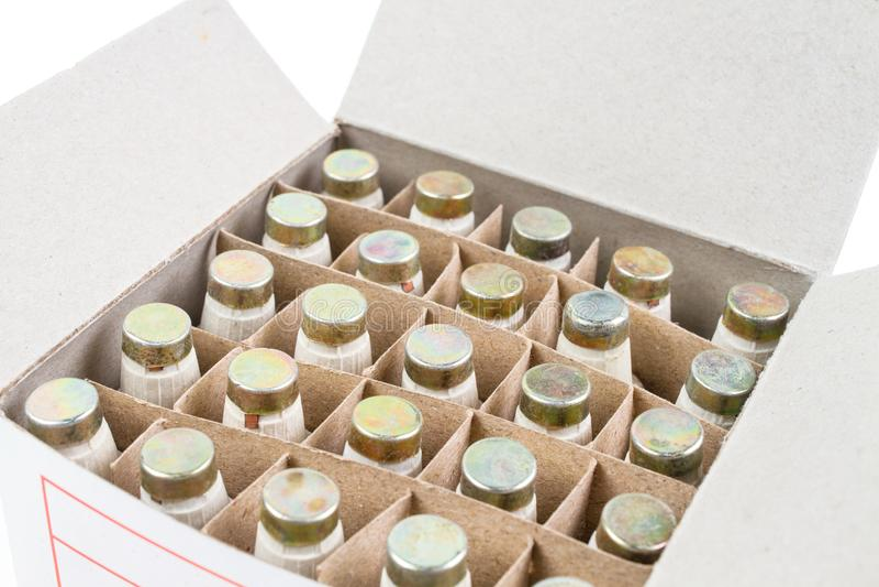 Beaucoup fusible de bouteille de Diazed dans le paquet de boîte de papier photos libres de droits