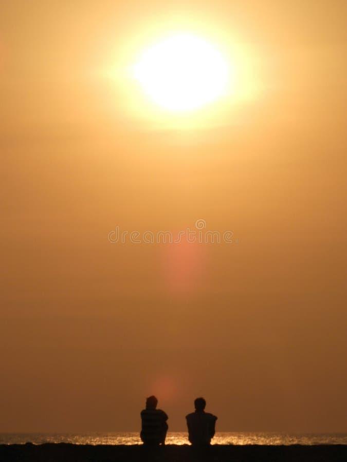 Beaucoup peut se produire au-dessus du coucher du soleil ! photos stock