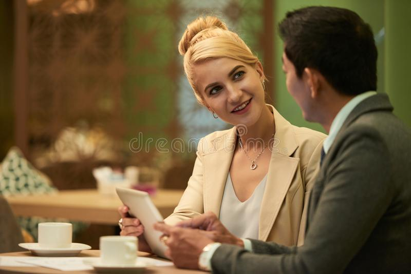 Business woman talking to colleague royalty free stock photos
