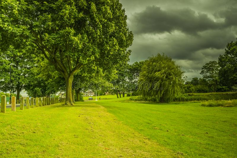 Beauiful park landscape. Beauiful park landscape with cloudy sky royalty free stock photo