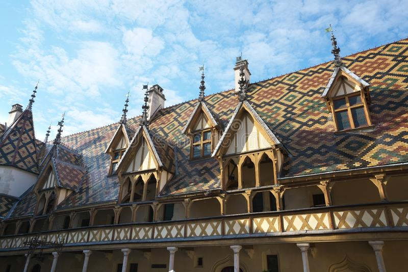 Hospices de Beaune or Hotel-Dieu in Beaune, France. Beaune,France-October 15, 2018: Hospices de Beaune or Hotel-Dieu in Beaune, France stock photo