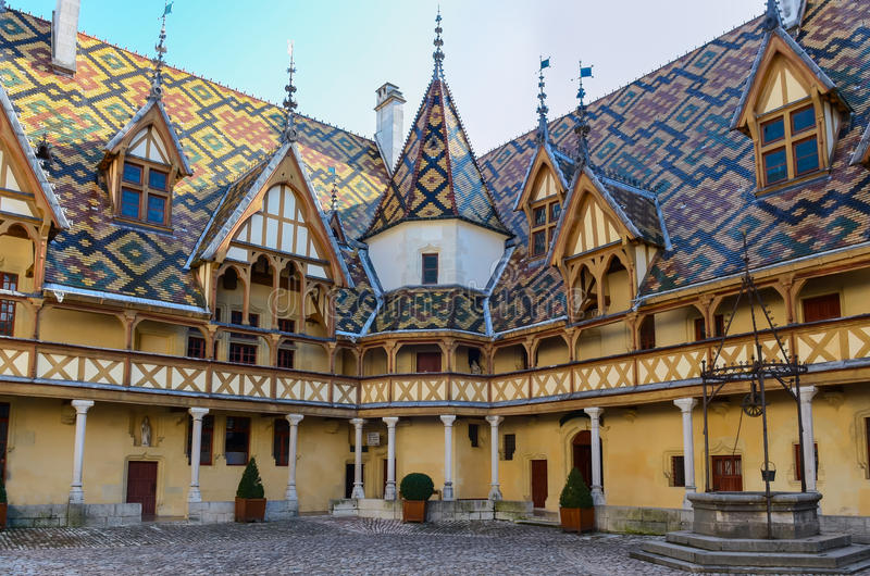 Beaune Hotel Dieu colorfu roofs. Beaune bourgogne city Hotel Dieu colorful roofs, France royalty free stock image