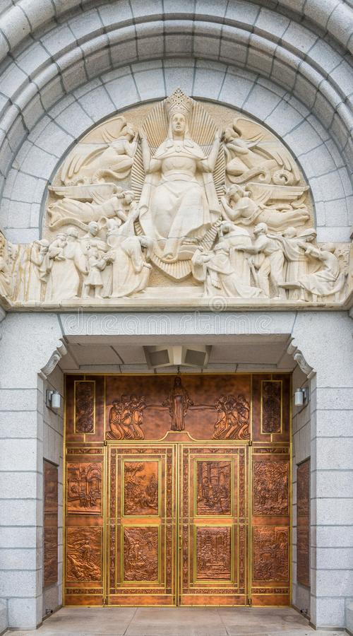 View at the doors of Basilica Sainte Anne de Beaupre in Canada. BEAUPRE,CANADA - JUNE 17,2018 - View at the doors of Basilica Sainte Anne de Beaupre. The stock photography