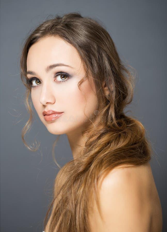 Beauté de cosmétiques de brune photo stock