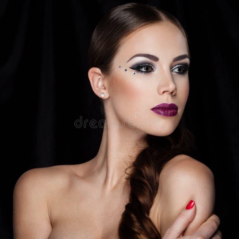 Beauté sur le noir photo stock