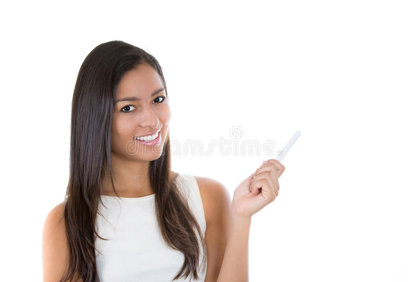 Beautful woman holding up chalk pointing to copy space royalty free stock image