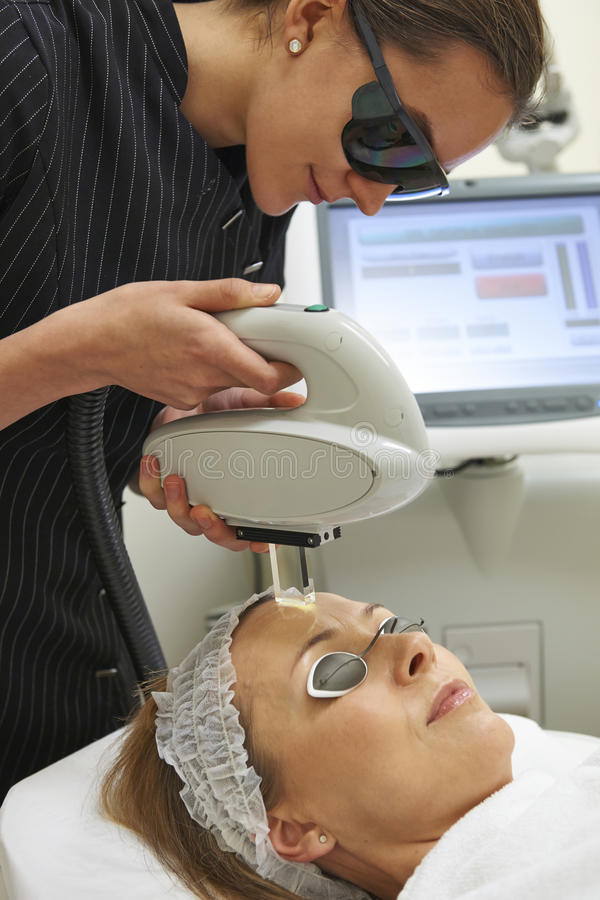 Beautician Carrying Out Fractional Laser Treatment. On Client stock images