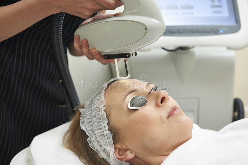 Beautician Carrying Out Intense Pulse Light Treatment stock image