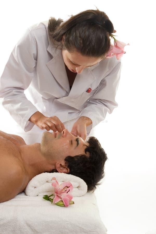 Beautician con il cliente maschio immagine stock