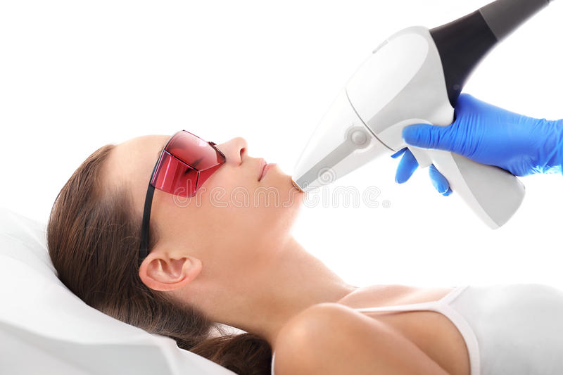 Beautician, laser hair removal stock image