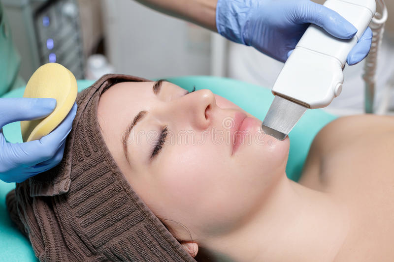 Beautician makes mechanical cleaning of the face. stock photography