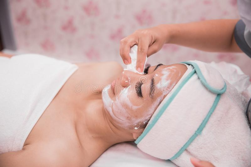 Beautician perform beauty treatment stock image