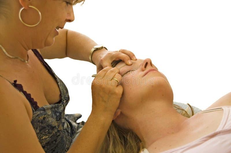 Beautician Tweezing Eye Brows stock photos
