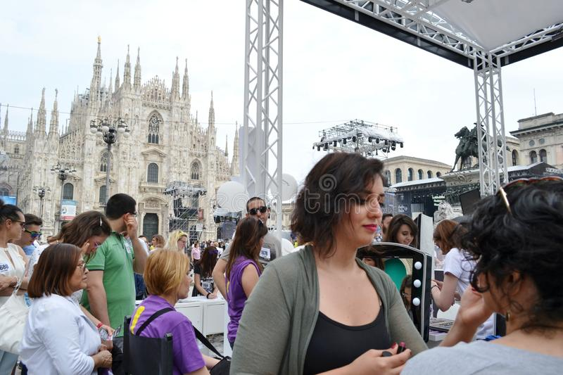 Beauticians receiving customers for free outdoors photo set `Brosway` in Milan Duomo square. stock photos