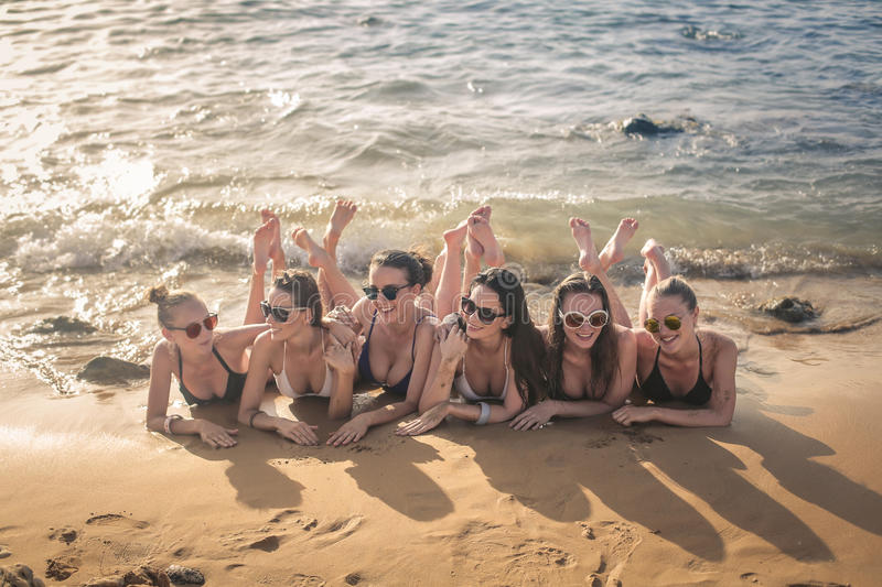 Beauties on the beach. Laying beauties on the beach stock photography