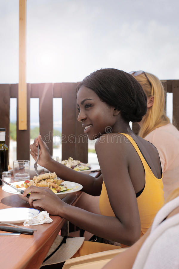 Beauties eating pasta. Beauties are eating pasta outdoor royalty free stock photos
