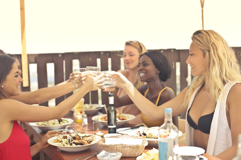 Beauties on vacation. Beauties having lunch on a vacation stock photography