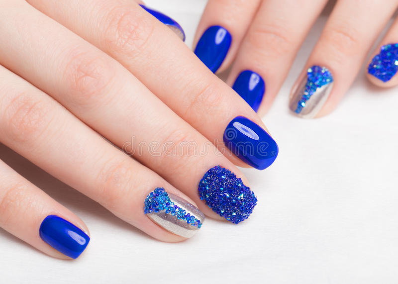 Beautifil blue manicure with rhinestone. Nail Design. Close-up.  stock image