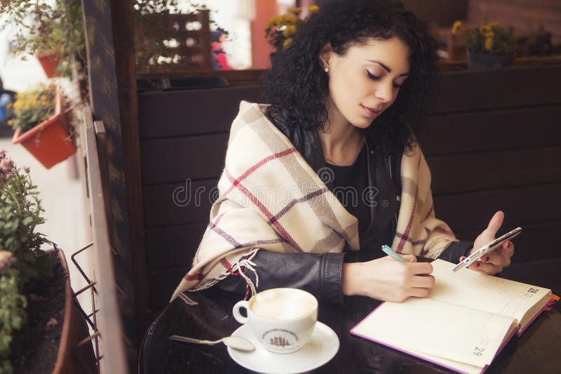 Beautifil brunette caucasian woman in leather jacket and plaid s royalty free stock images