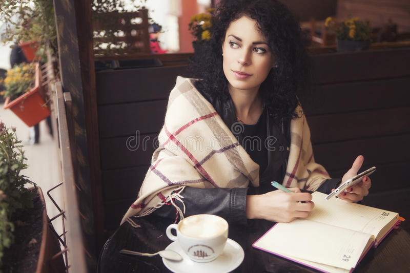 Beautifil brunette caucasian woman in leather jacket and plaid s royalty free stock photos