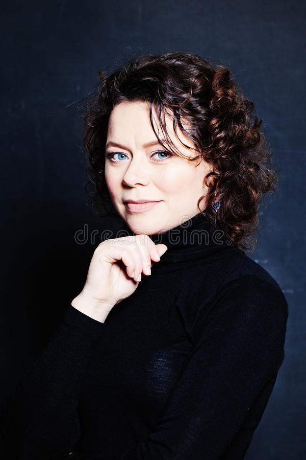 Beautifu Mature Woman with Short Curly Hair on Blackboard royalty free stock images