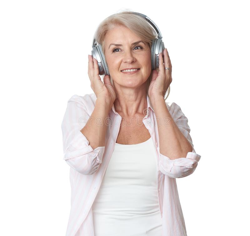 Free Beautiful 50 Years Old Woman Is Listening To Music In Headphones Stock Photo - 158340280