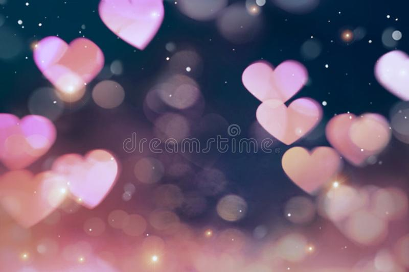Beautiful abstract blurred pink hearts on dark background.. Beautiful abstract blurred pink hearts bokeh on dark background. Sweet and romantic wallpaper royalty free stock images